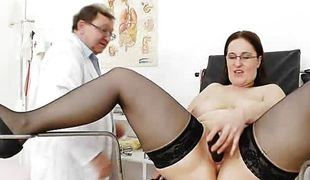 Fat brunette has her cunt spread by the doctor
