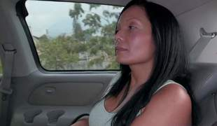 Raven haired busty Colombian mommy Casandra is proud of her perfect huge fake boobs. Thats why she takes off her stingy apex and brassiere in the back of a car in front of the camera with no shame!