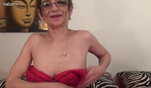 Ripened horny bitch is kneeling on the bed to finger her taut anus