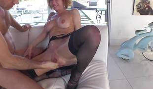 Sexy redhead in black stockings acquires gangbanged hard