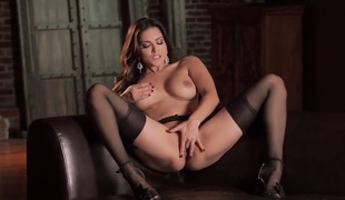 Dark haired honey Sunny Leone with large soaked boobs and breathtaking beautiful face in nylons and high heels spreads legs and fingers soaked honey pot to warm orgasmic feeling.